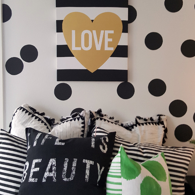 White wall with black Polka Dots