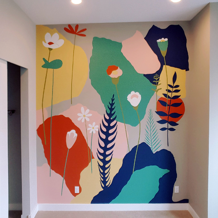 Vibrant colored shapes with flowers painted on a wall